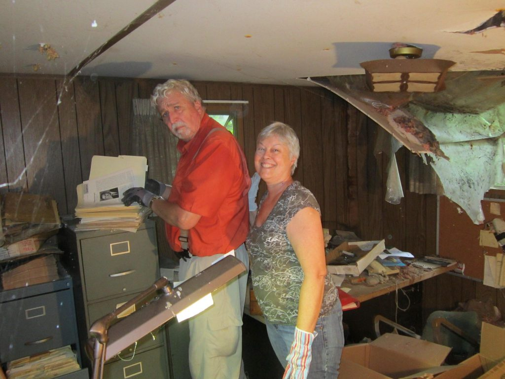 Dr. Tom John and Mary Ruth Martin look through Bill's papers in his farm trailer office