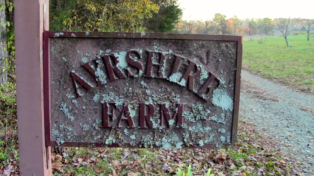 An old, rusted sign of Ayrshire Farm